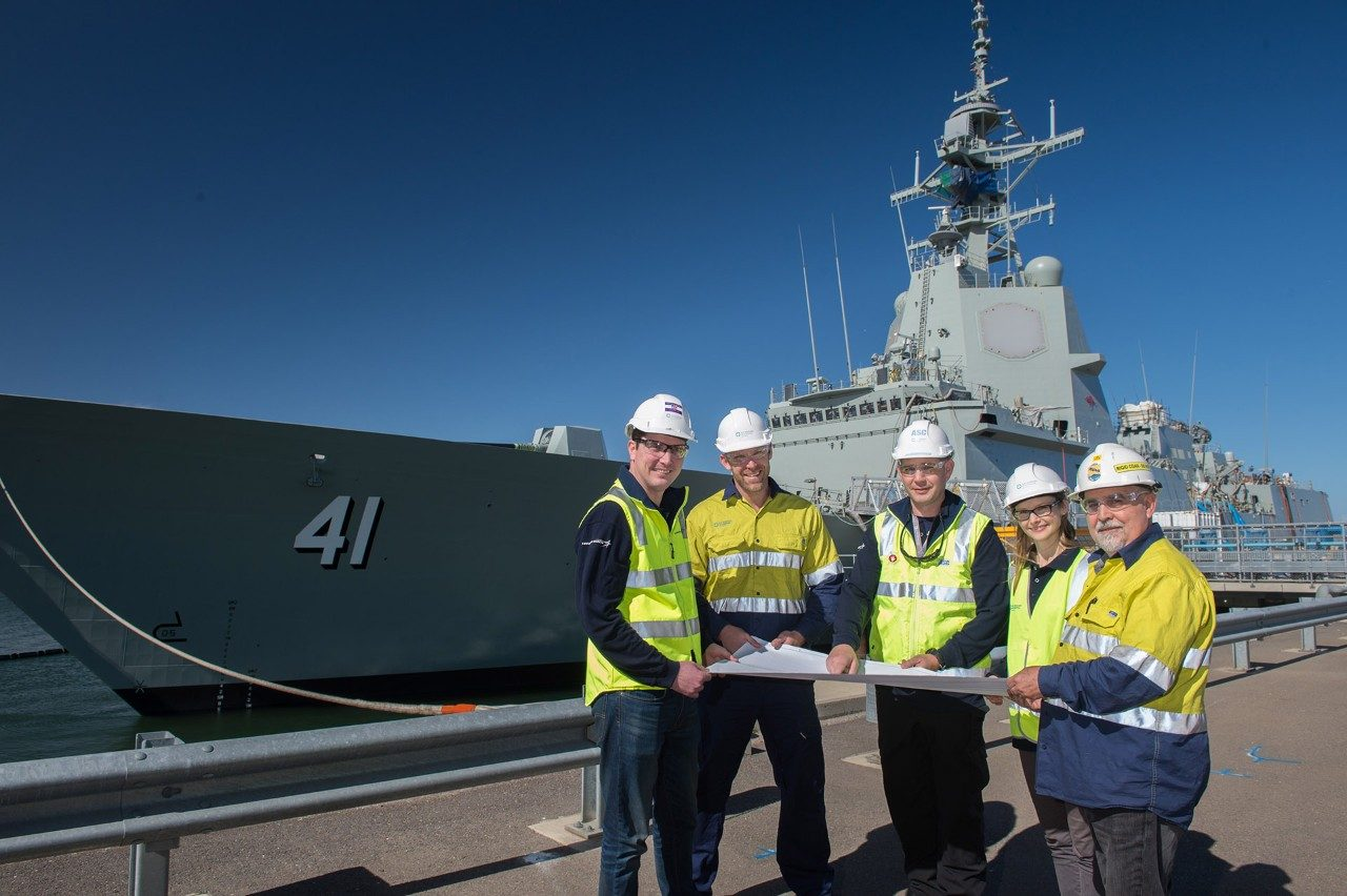 DJ Daniel (centre) with members of his Lockheed Martin Australia team at the Adelaide shipyard.