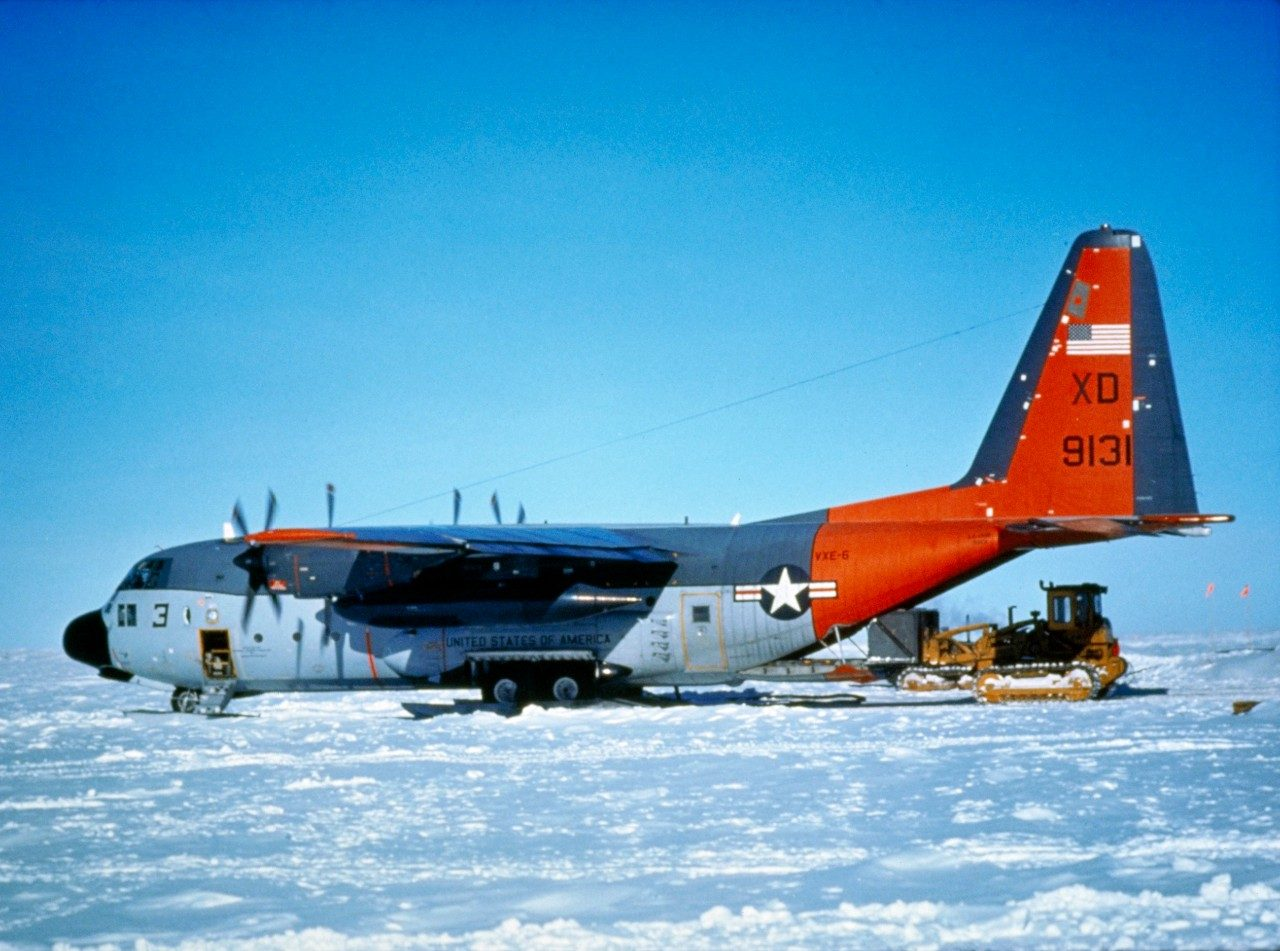 Cargo is being removed from a ski-equipped LC-130H Hercules. The LC-130H is designed for winter or arctic operations.