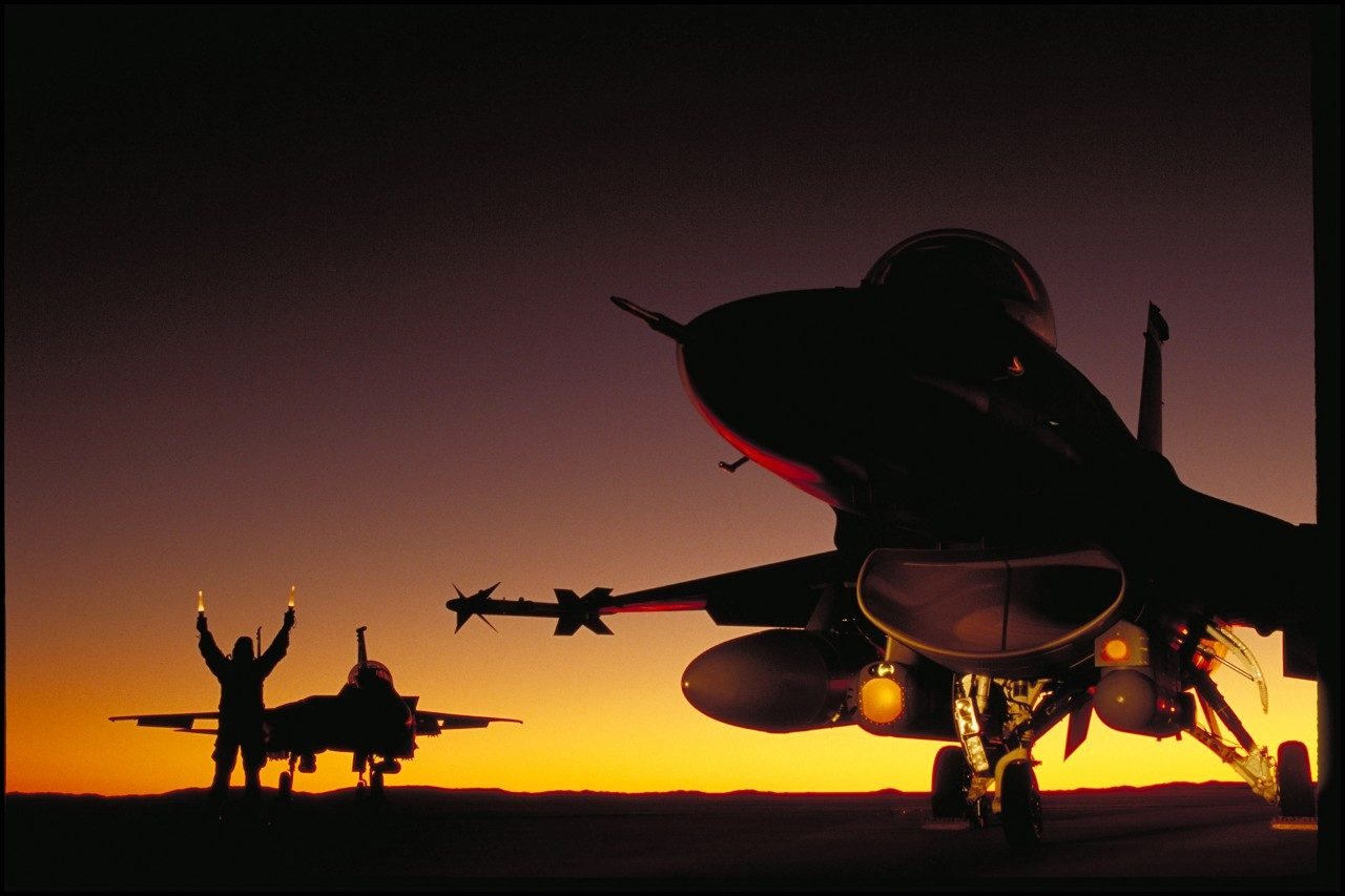 LANTIRN mounted beneath an F-16, landing at dusk, circa 1994.