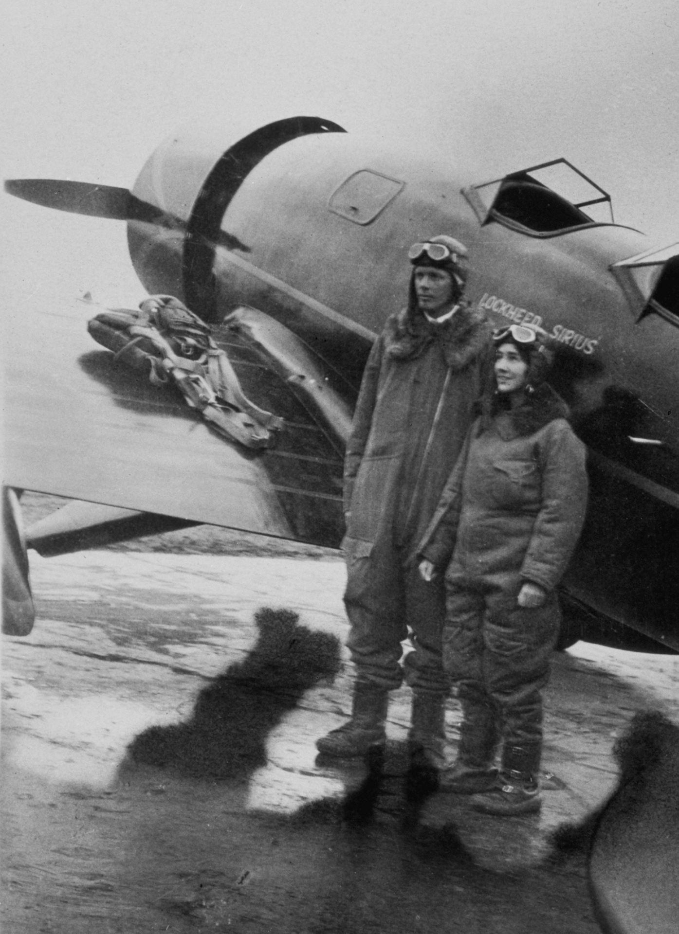 Charles and Anne Lindbergh in front of Sirius.