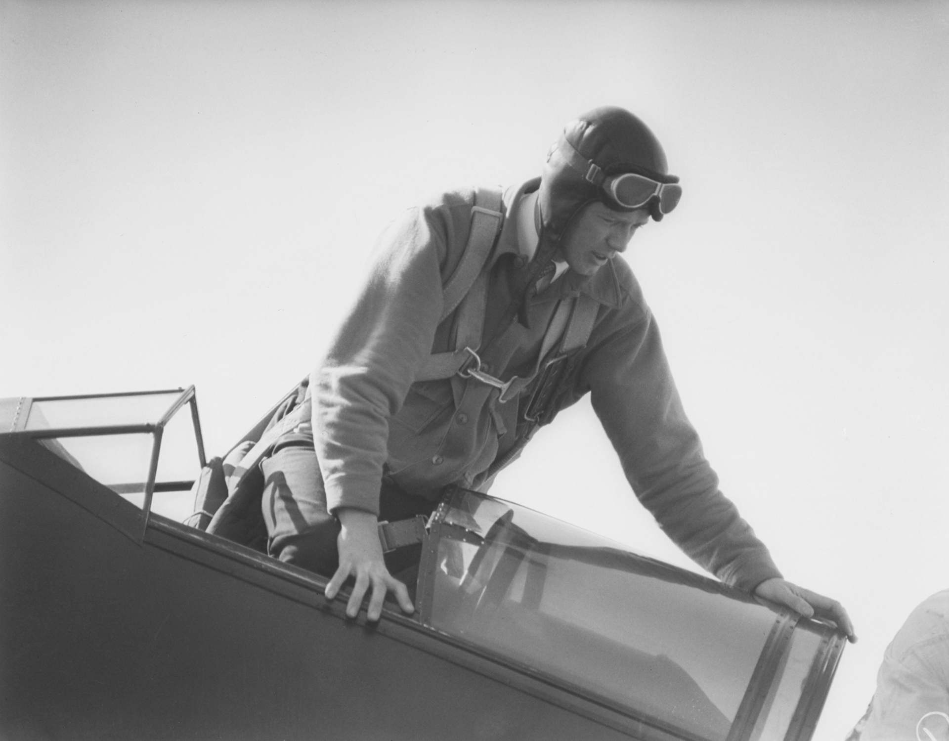 Charles Lindbergh climbs into the open cockpit of his Sirius.