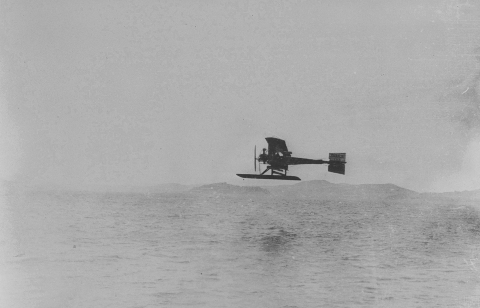 Model G in flight over San Francisco Bay