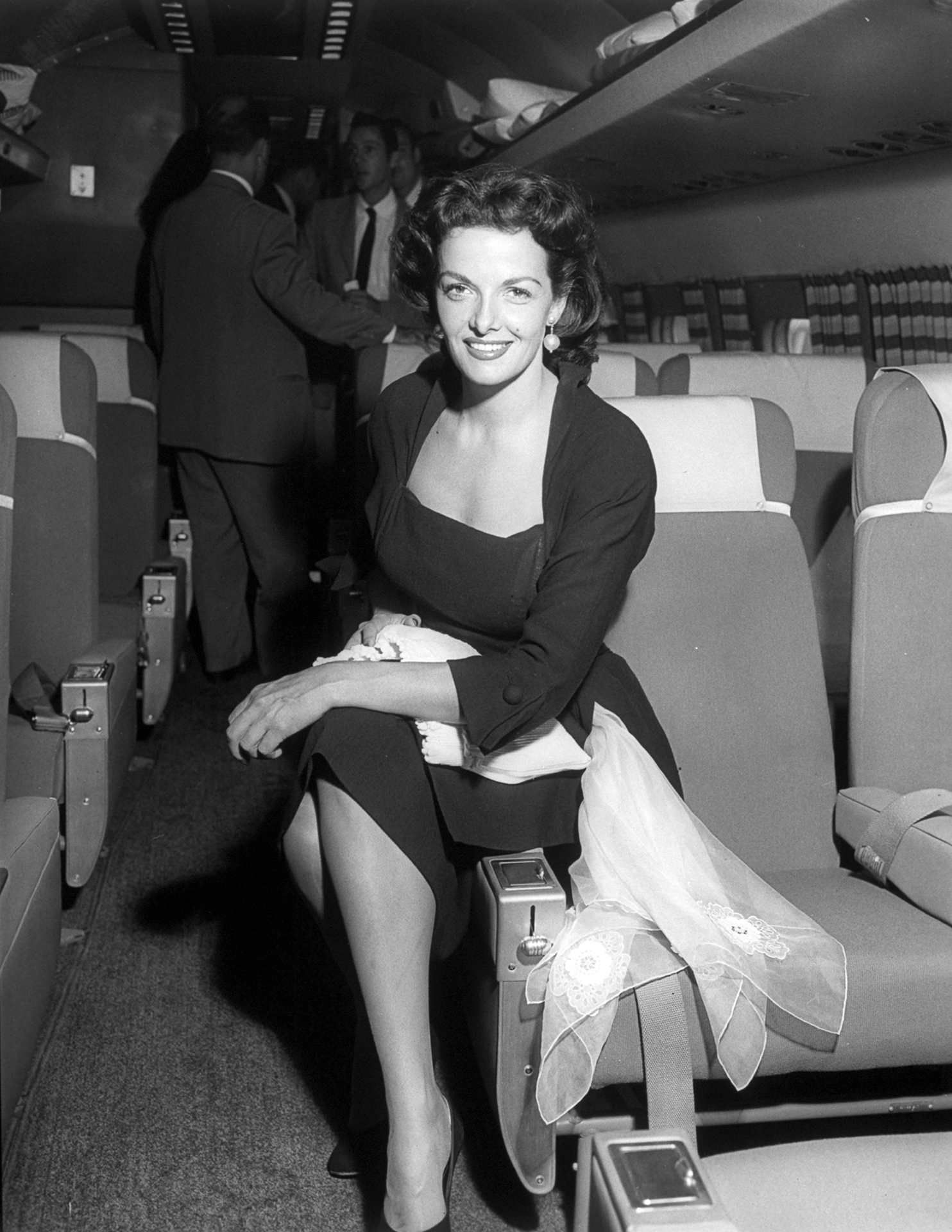 Actress Jane Russell onboard a Constellation promotional flight.