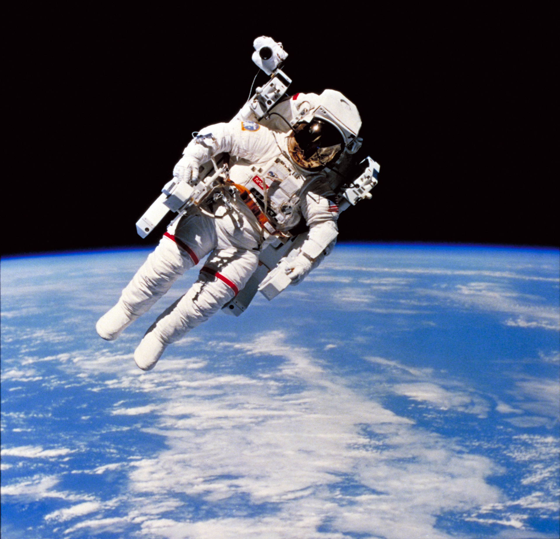 Manned Maneuvering Unit (MMU), a personal backpack propulsion system astronauts wear when working in orbit outside the Space Shuttle.