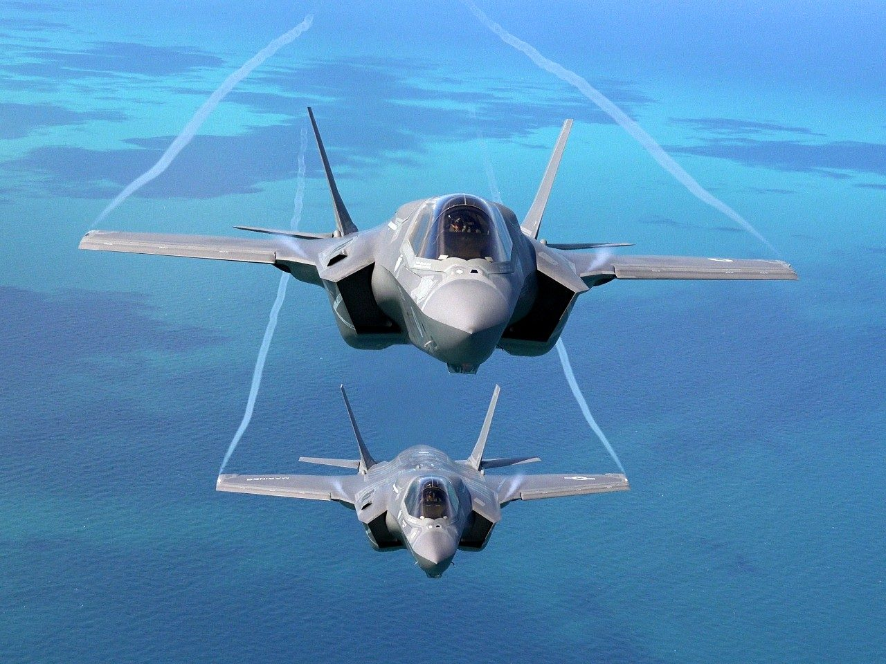 A UK F-35 flies above a USMC F-35 over the UK in 2016